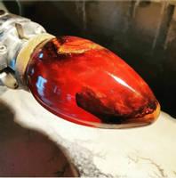Red-Resin-Egg-on-Lathe-Lightning-Wood-Designs Thumbnail