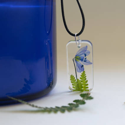 Blue Flower Resin Pendant by Flauropia