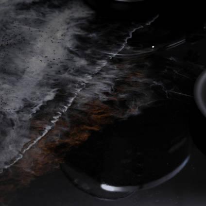 GlassCast Cosmic Black Granite Resin Countertop Coffee Cup Closeup