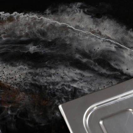 GlassCast Cosmic Black Granite Resin Countertop Sink Corner Shot