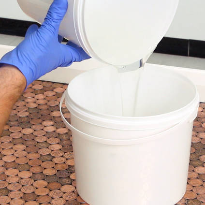 Pouring Epoxy Resin from One Mixing Bucket to Another