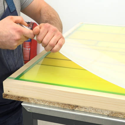 Polypropylene Sheet Being Peeled Away from Cured Resin Table