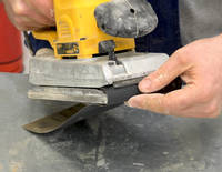 Abrasive Paper Being Fitted to an Orbital Sander Thumbnail