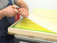 Polypropylene Sheet Being Peeled Away from Cured Resin Table Thumbnail